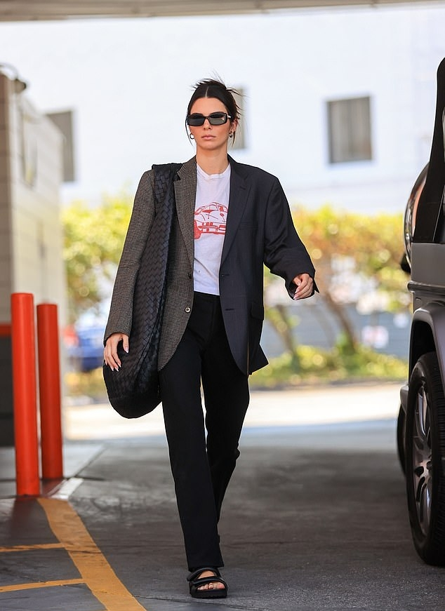 Kendall Jenner rocking round brown two-strap mules by baltini with flat heel