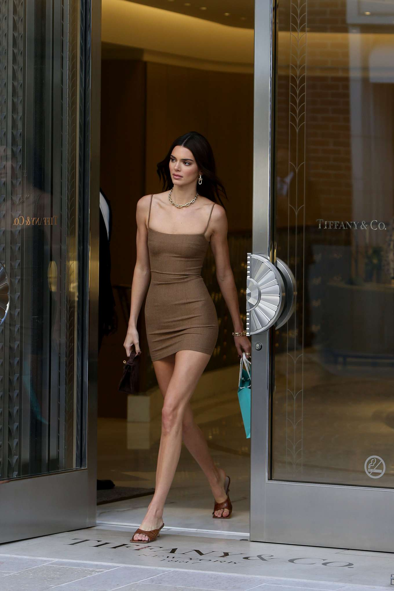 Kendall Jenner rocking brown leather open toe sandals with pointy heel