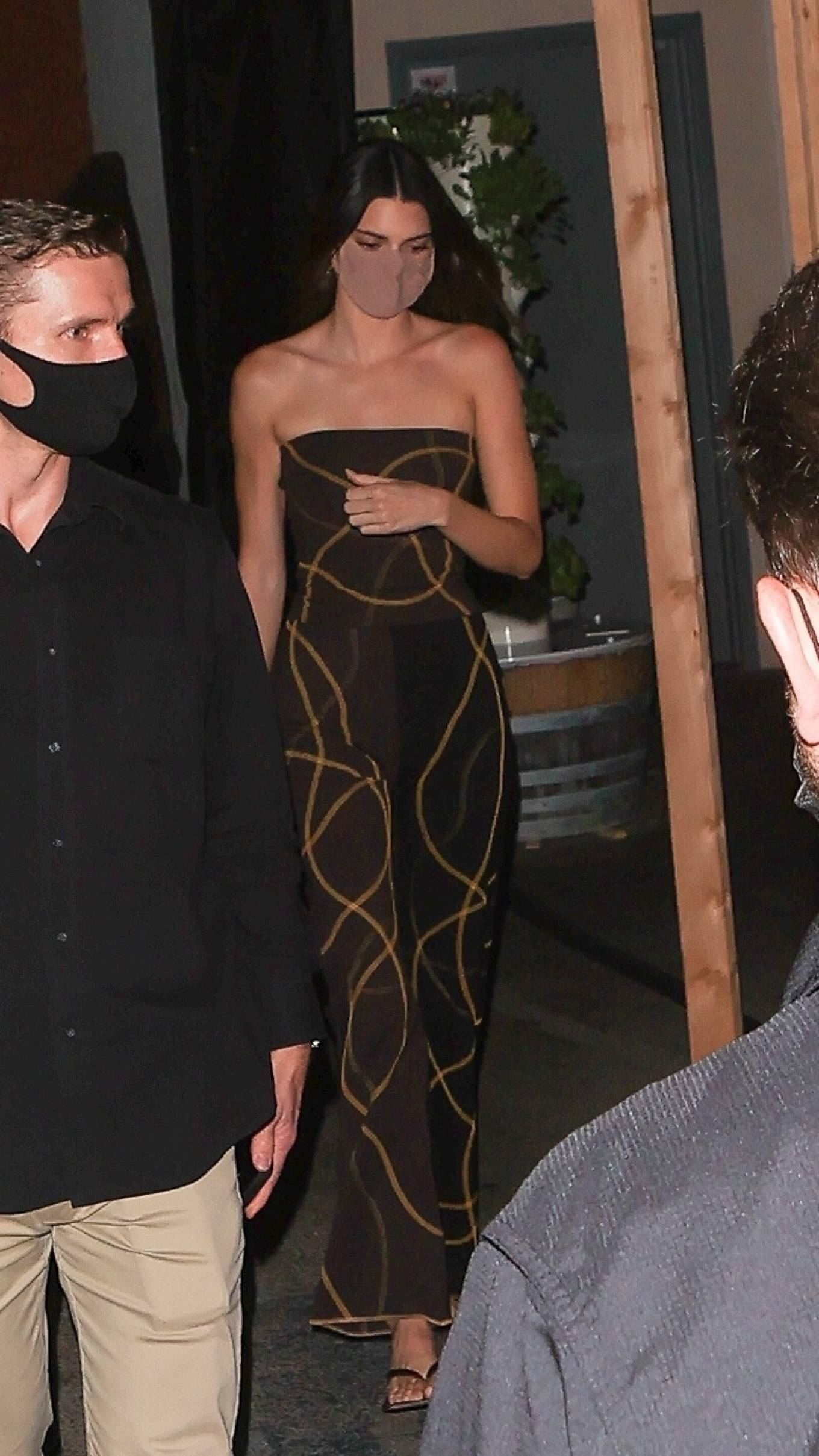 Kendall Jenner rocking straight fit bi color patterned print flare trousers with flared hem
