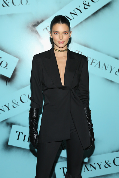 Kendall Jenner donning matching black flared hem trousers with gathered hem