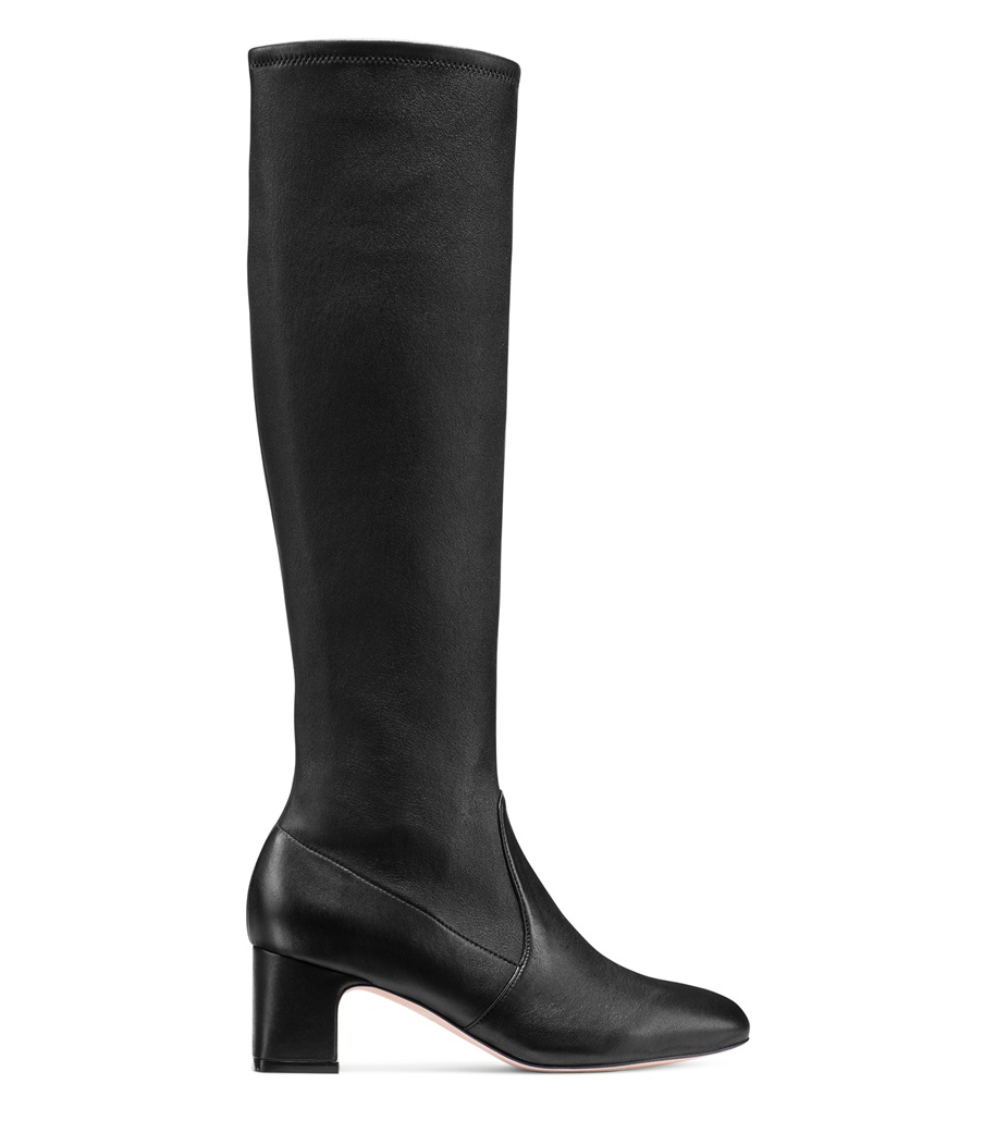 Kendall Jenner wearing narrow black patent-leather knee high boots by Stuart Weitzman with high heel