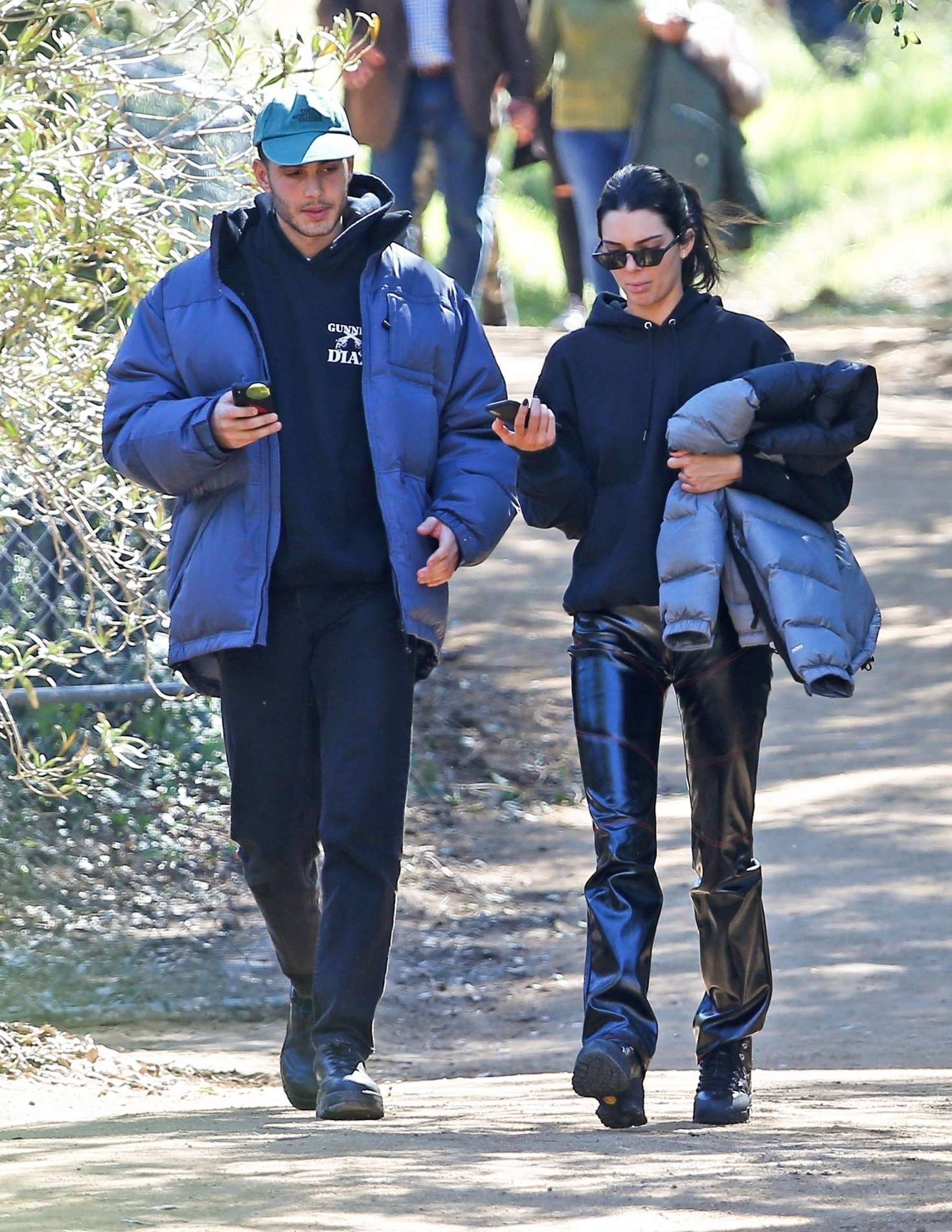 Kendall Jenner rocking black leather ankle boots with chunky sole