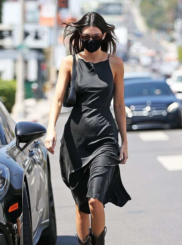 Kendall Jenner rocking pointed black leather high top boots by Ganni