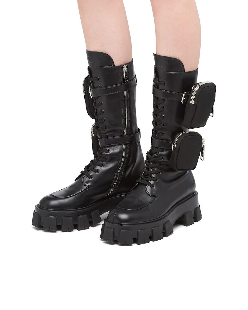 Kendall Jenner rocking black Prada mid calf boots with chunky sole