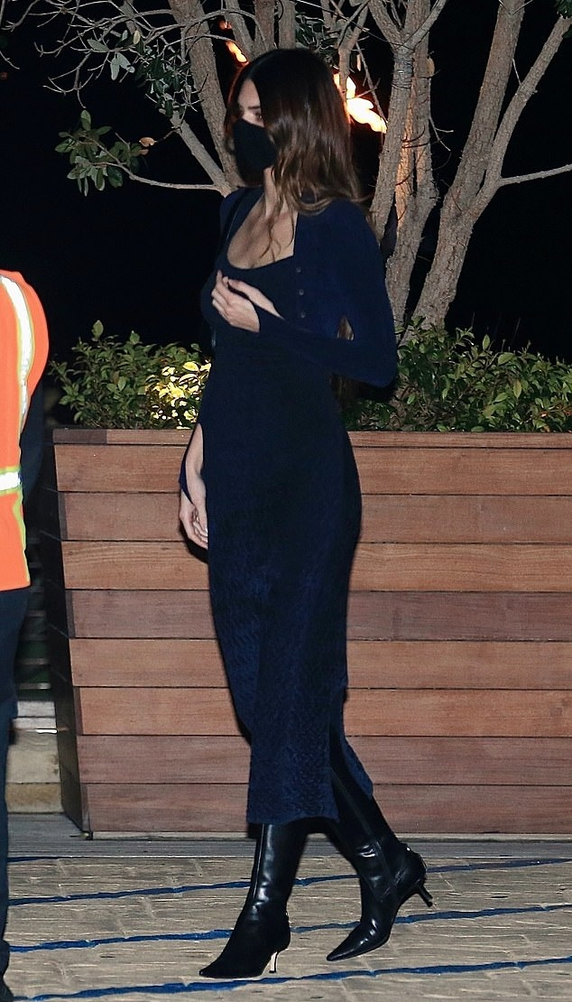 Kendall Jenner rocking pointy black leather mid calf boots with pointy heel