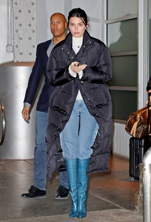 Kendall Jenner donning a black button front quilted jacket with full sleeves and stand-up collar