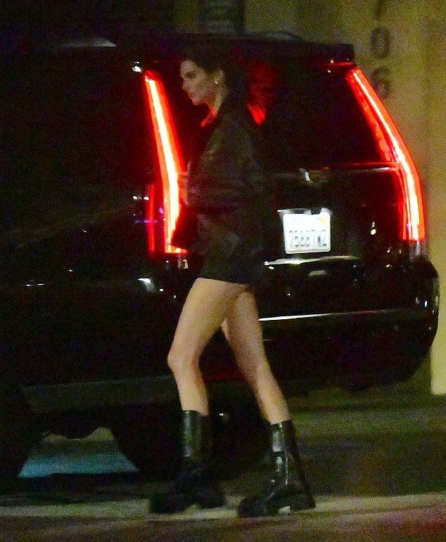 Kendall Jenner rocking a Figure hugging black dress with a scoop neck