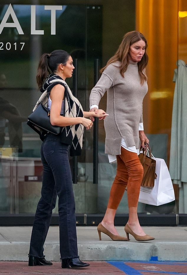 Kendall Jenner donning pointed black leather ankle boots by The Row