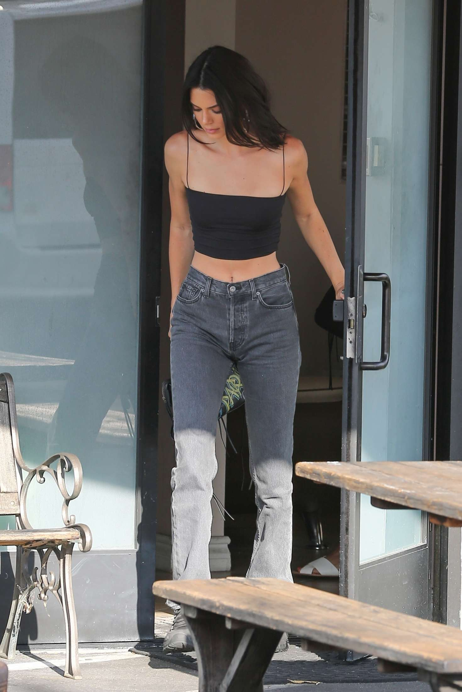 Kendall Jenner donning chunky grey Reebok lace-up sneakers with chunky sole