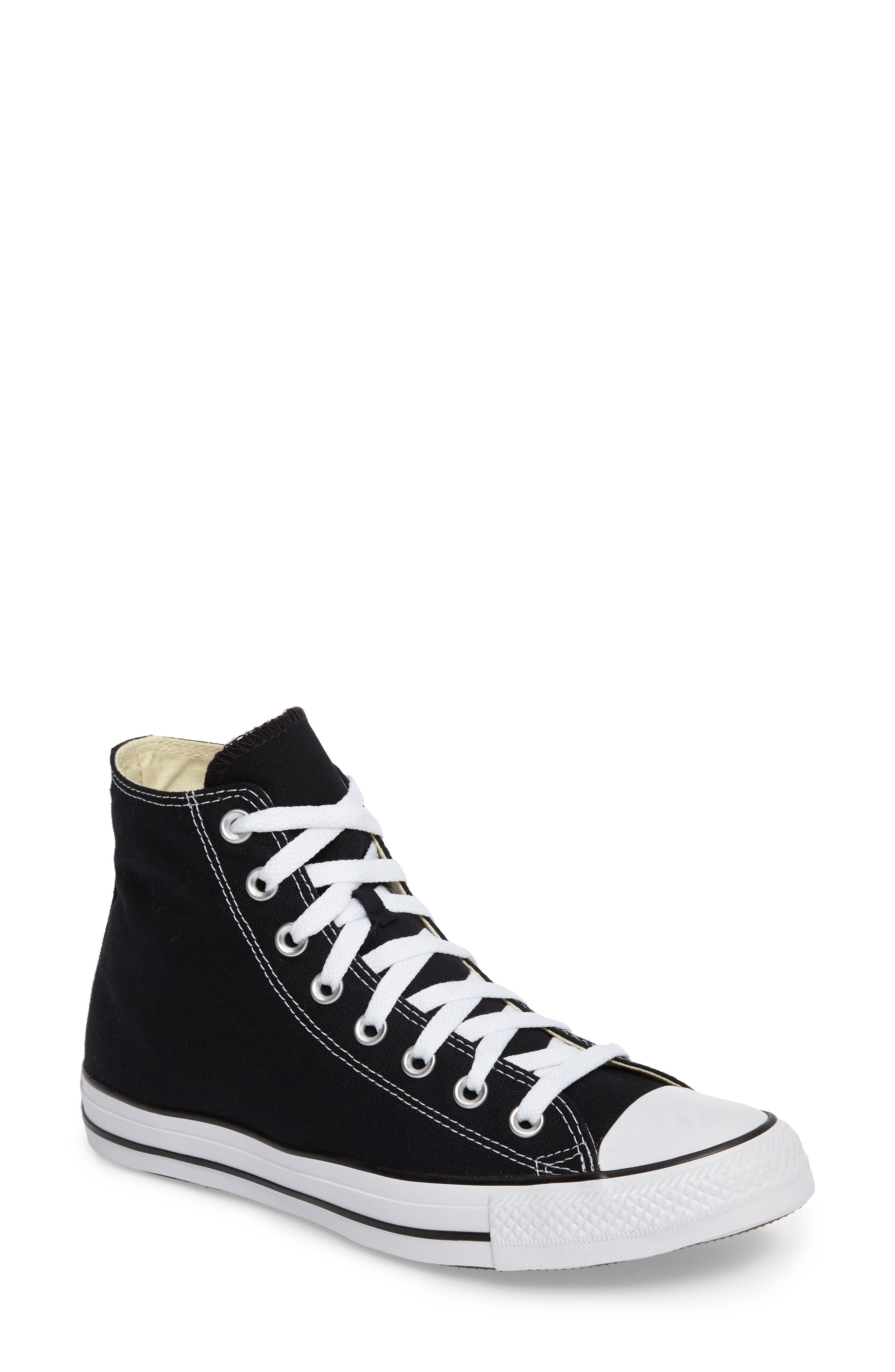 Kendall Jenner donning black Converse ankle canvas shoes