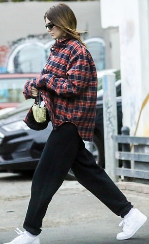 Kendall Jenner wearing round white Nike lace-up sneakers