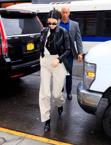 Kendall Jenner rocking a monochrome white and black woolen bodysuit with a turtleneck