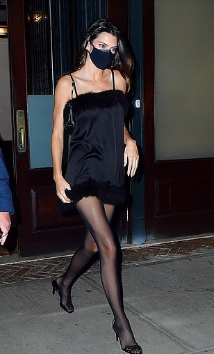 Kendall Jenner wearing round black slingback sandals with stiletto heels