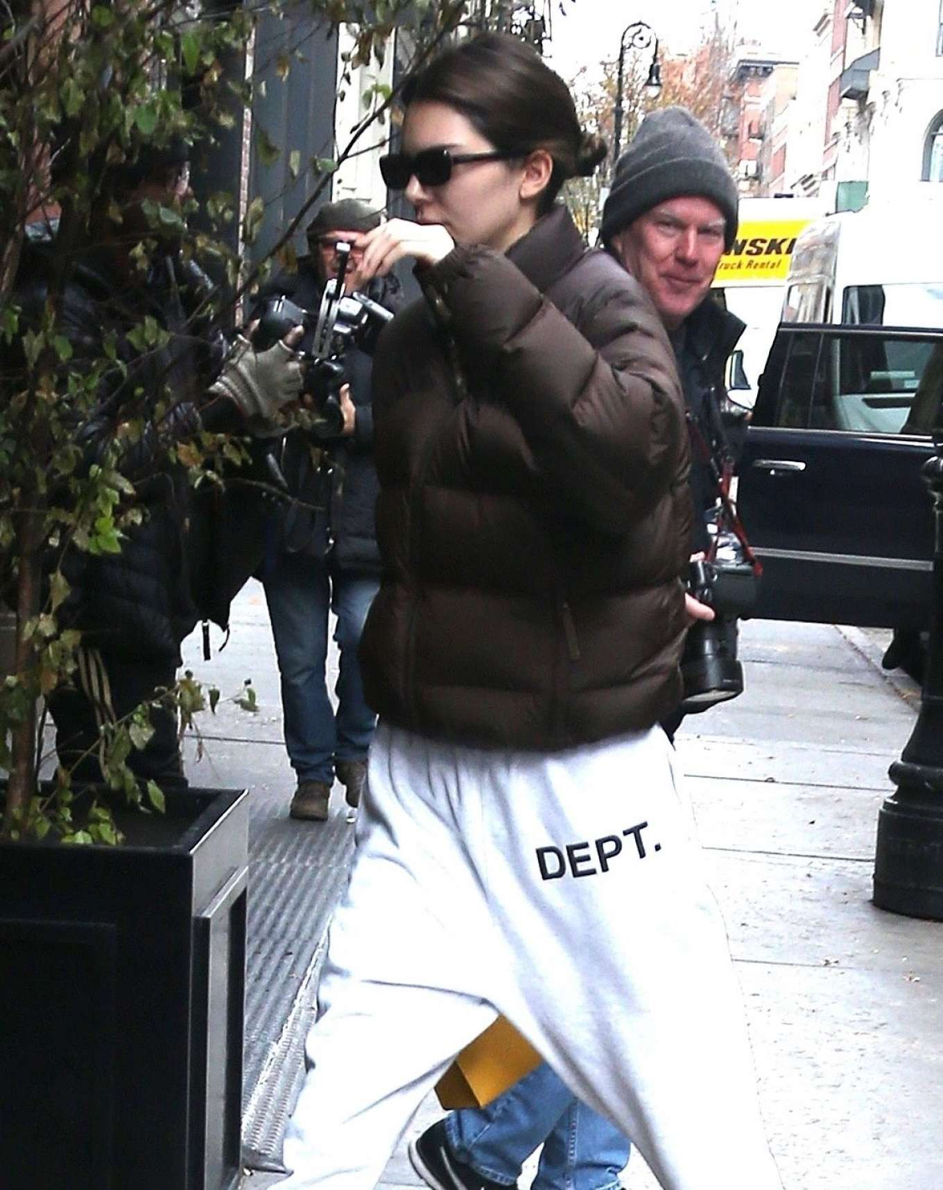 Kendall Jenner rocking striped white blue lace-up trainers
