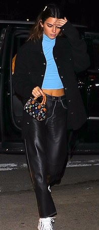 Kendall Jenner rocking Straight fit black leather ankle length jeans with piping and a leather fabric