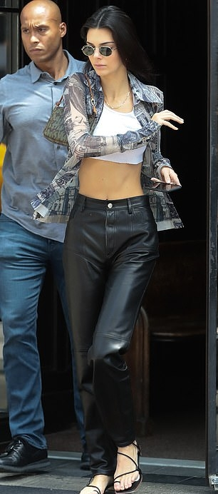 Kendall Jenner wearing Straight fit black leather high rise jeans with a leather fabric