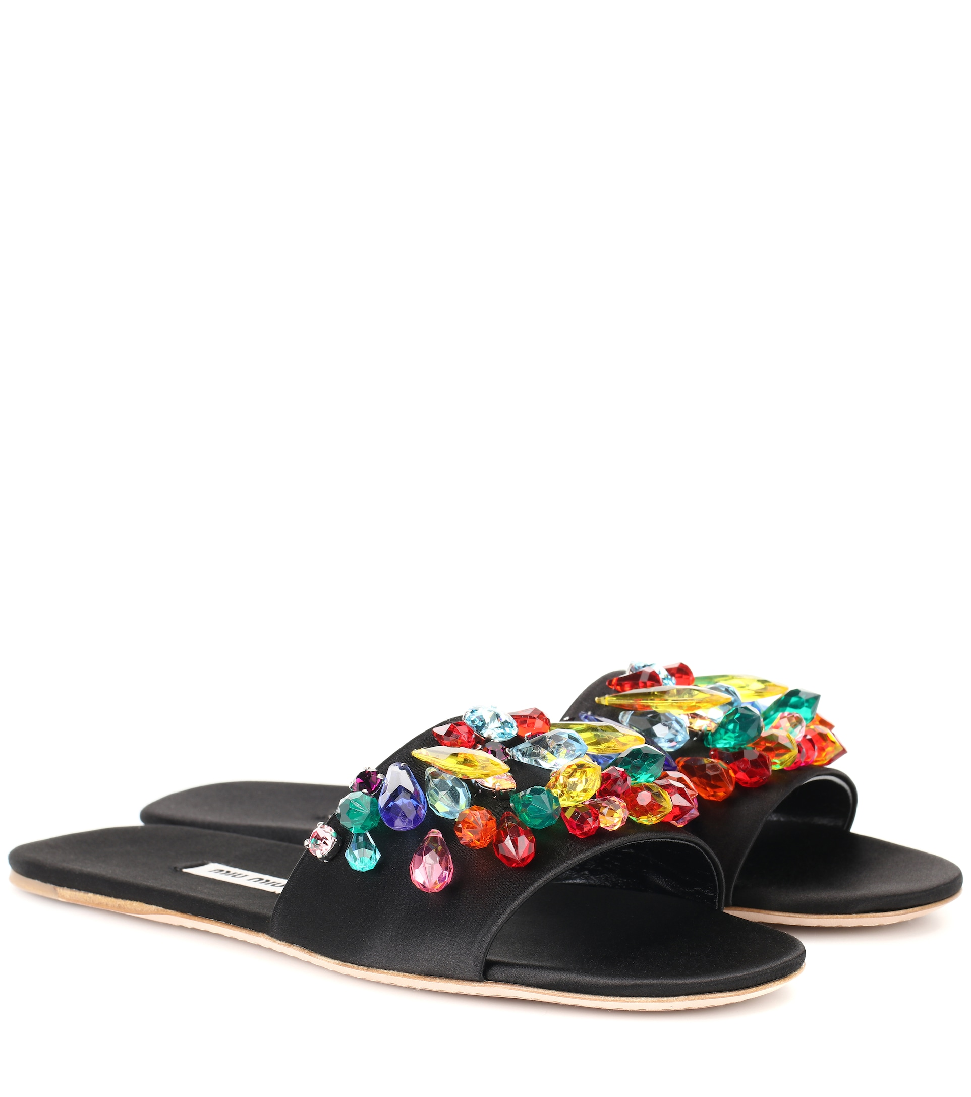 Kendall Jenner donning embellished black multicolor open toe flats with flat heel and beaded