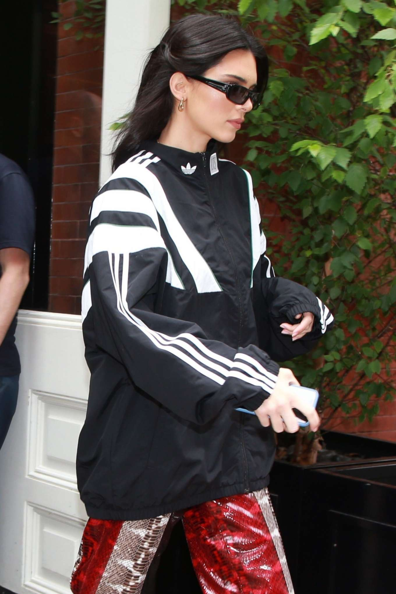 Kendall Jenner donning white Adidas lace-up sneakers