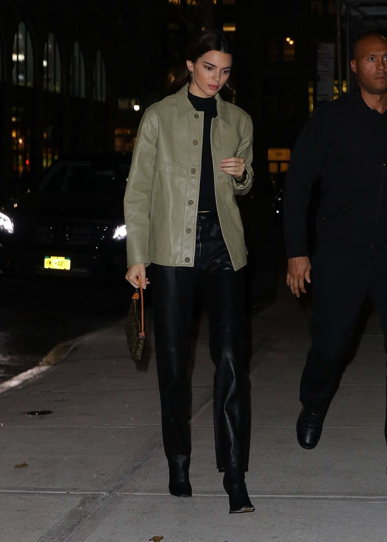 Kendall Jenner rocking Narrow fit black leather jeans with a leather material