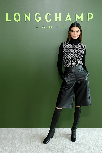 Kendall Jenner rocking narrow black Long Champs knee high boots with block heel