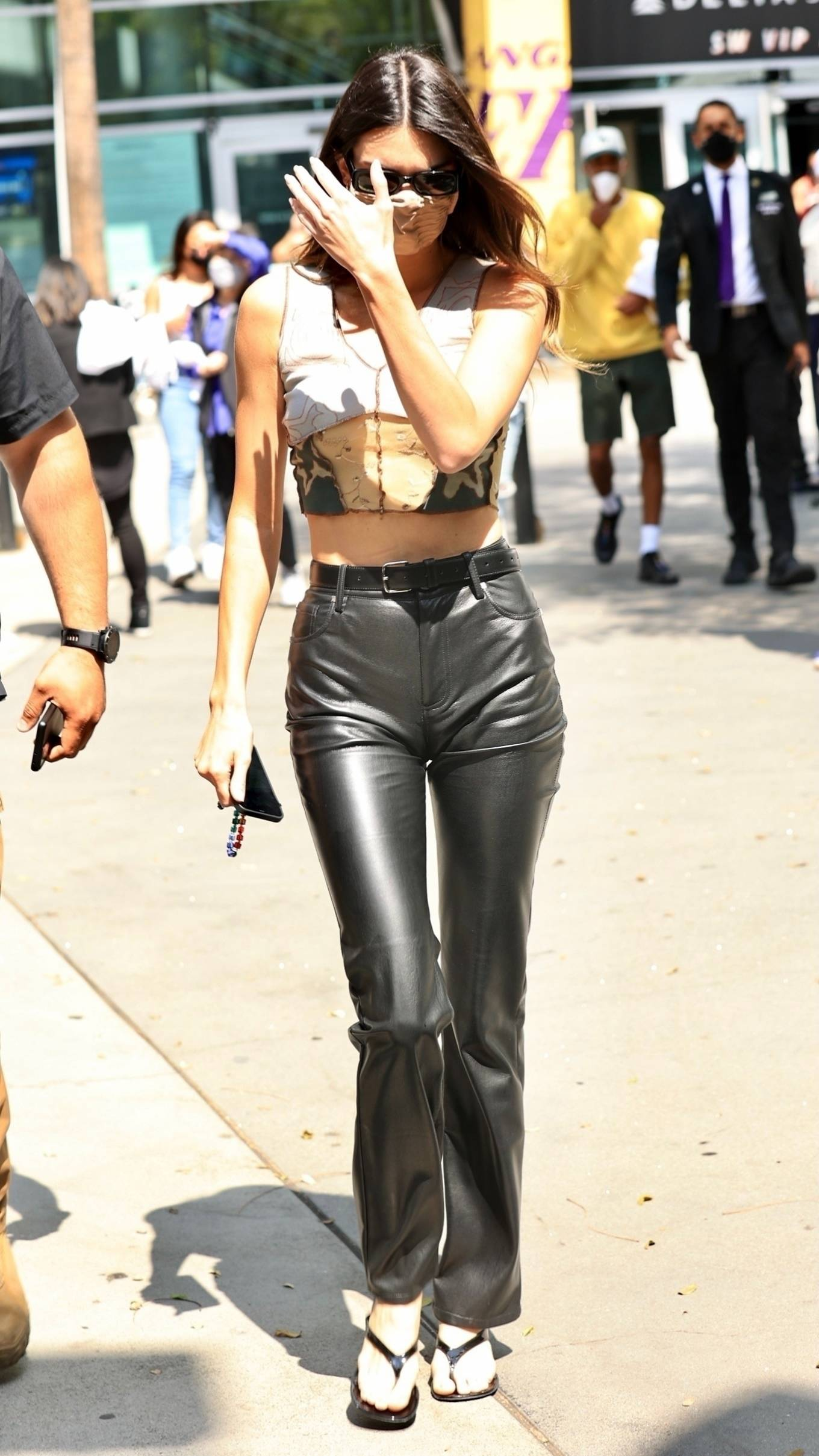 Kendall Jenner wearing straight fit black high rise trousers