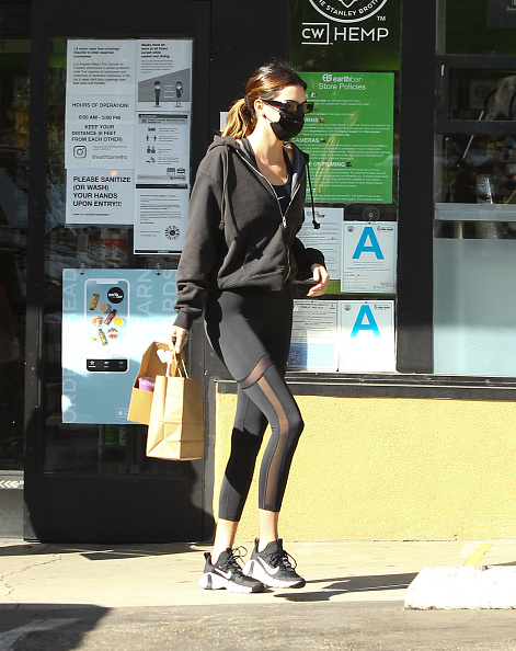Kendall Jenner rocking skinny black mesh ankle length workout leggings while smoothie with best friend Hailey Bieber in Hollywood