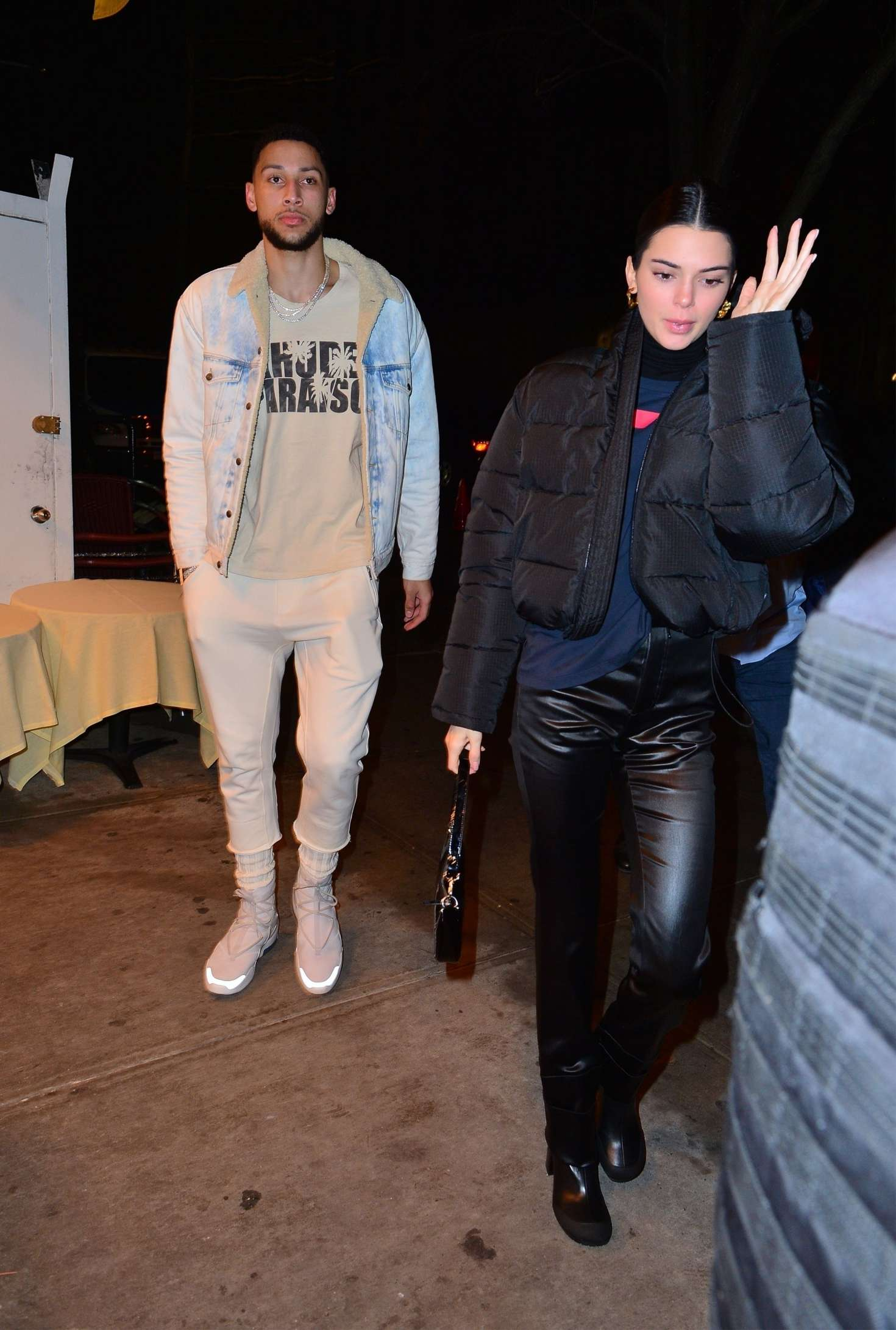 Kendall Jenner rocking black leather boots with square heel
