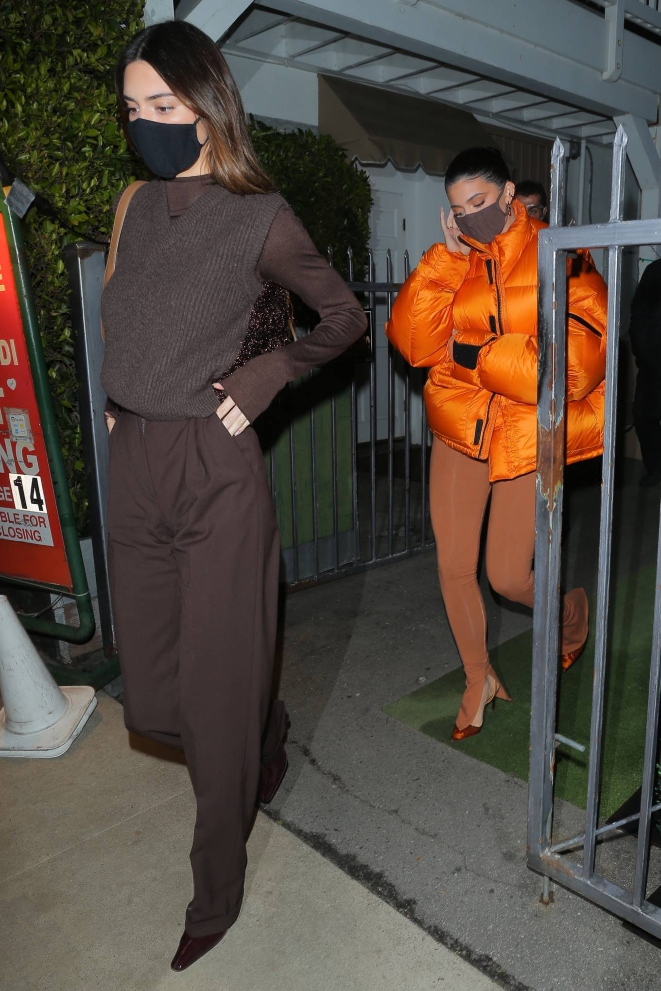 Kendall Jenner, Maison Margiela  sweater, brown  sweater, brown Jil Sander jumper, brown boots, knit, waist length, sleeveless, V-neck, casual, brown trousers