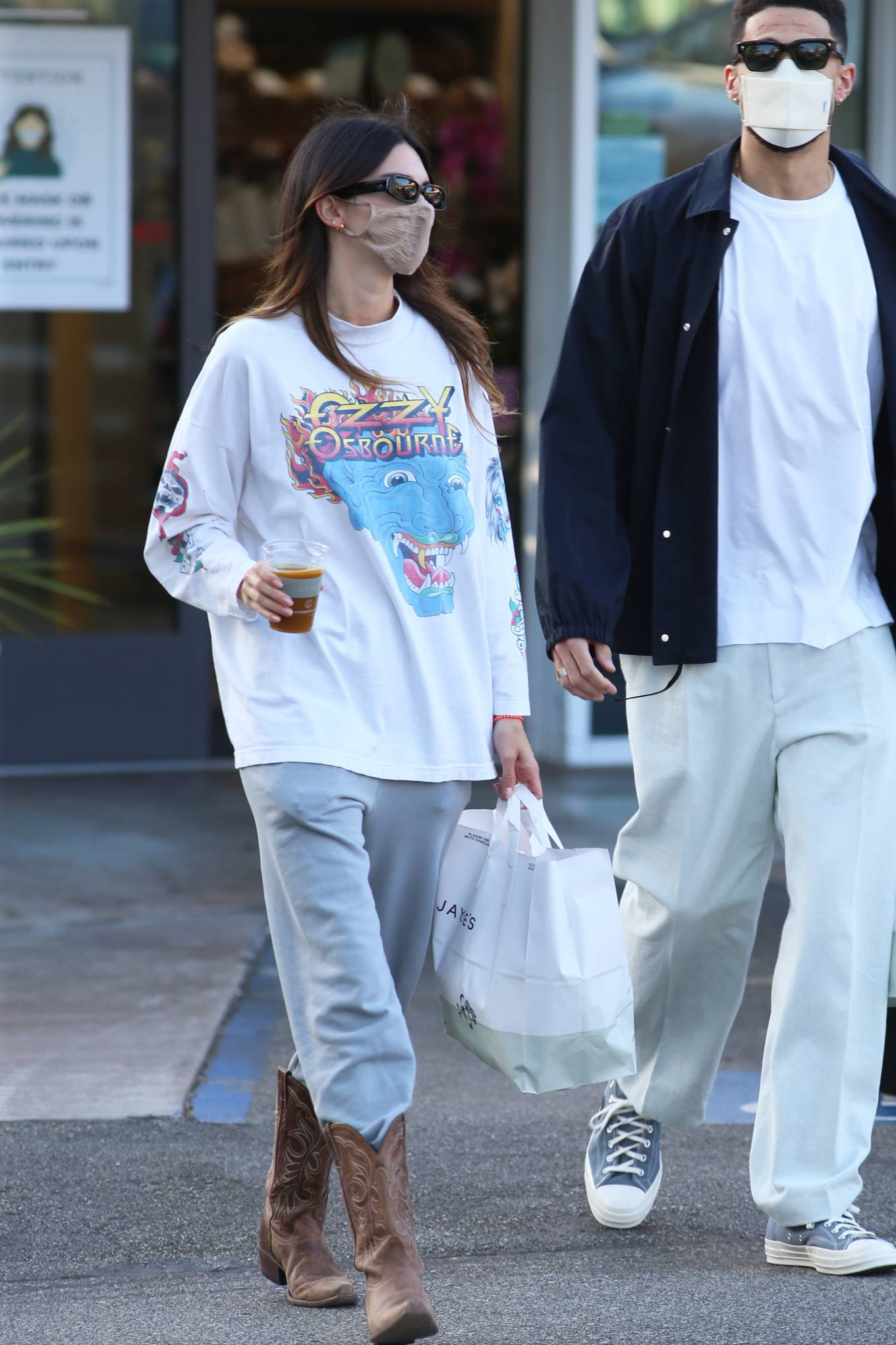 Kendall Jenner donning a oversized cotton graphic tee with full sleeves and a crew neck