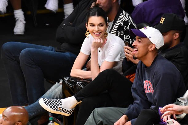 Kendall Jenner wearing see-through Yeezy PVC pumps with pointy heel and PVC-straps
