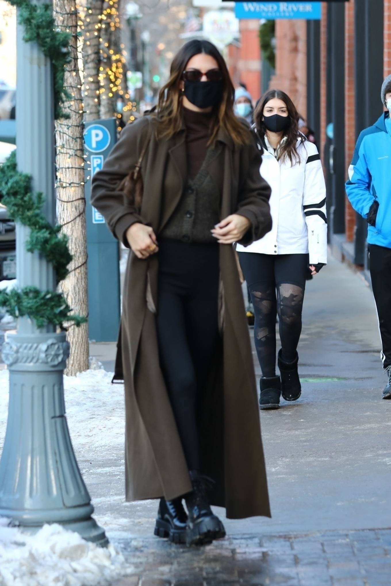 Kendall Jenner, black  leggings, Nike  leggings, black Prada boots, dark brown The Row trench coat, high rise, skinny, make the most, brown Fendi purse, dark grey sweater, sportswear inspired, black Velvet Canyon sunglasses, activewear