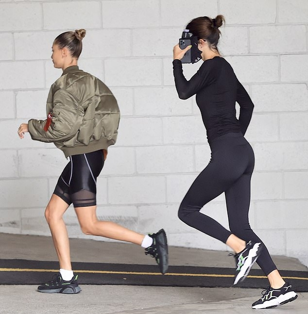 Kendall Jenner rocking Skinny black high rise ankle length workout leggings with a stretch fabric material