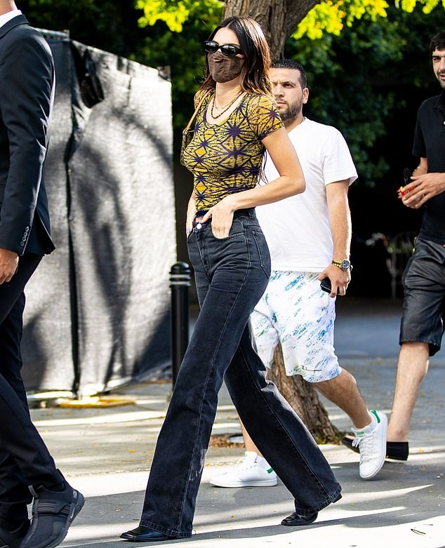Kendall Jenner donning straight fit black high rise jeans