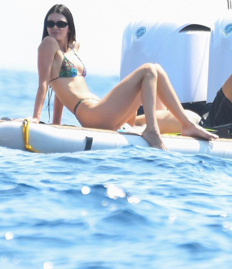 Kendall Jenner wearing skimpy floral bikini bottom with high waist
