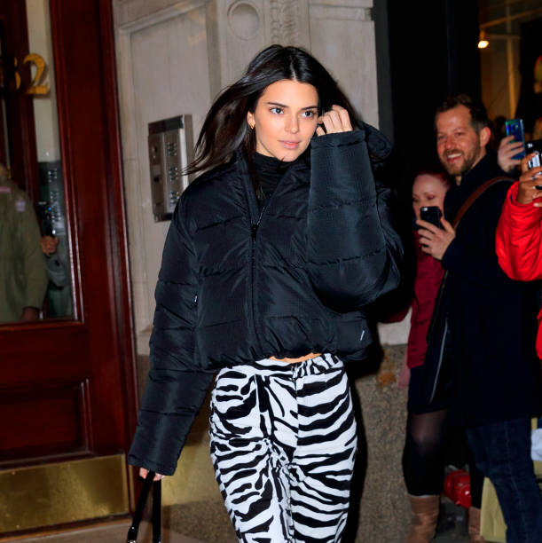Kendall Jenner rocking a oversized black Balenciaga quilted jacket with extra long sleeves