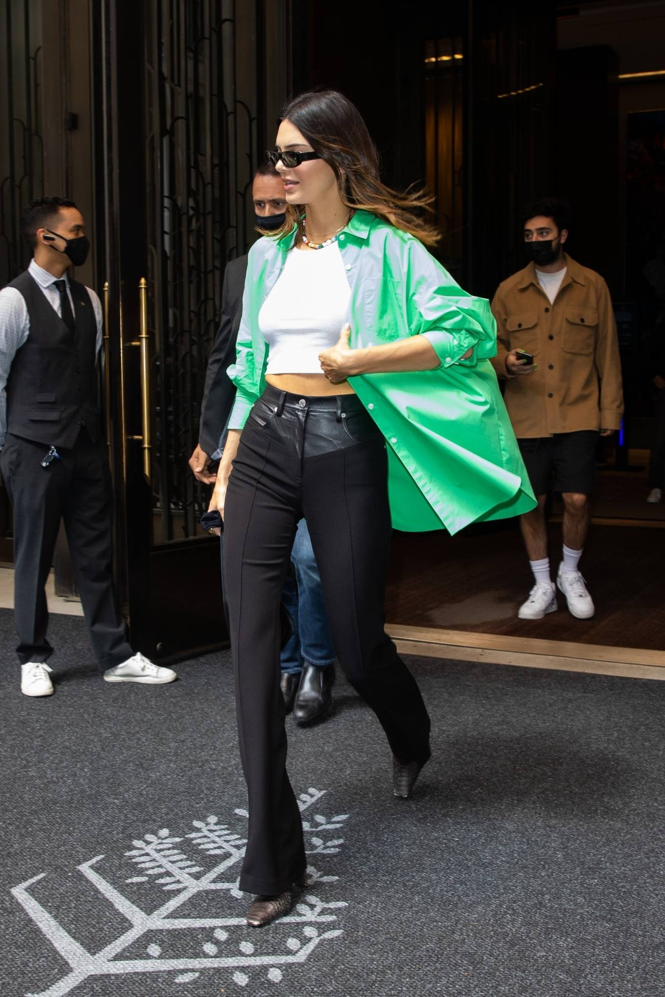 Kendall Jenner rocking a oversized green open front cotton shirt with rolled sleeves, shirt collar and button front