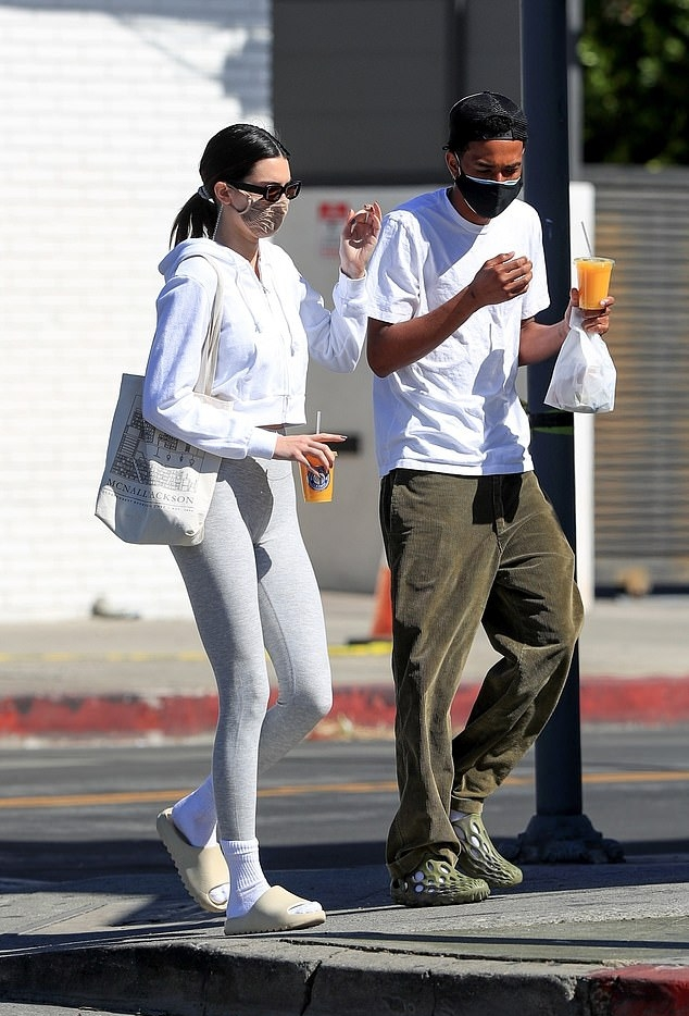 Kendall Jenner donning skinny grey high waist ankle length workout leggings while Horse riding in Malibu