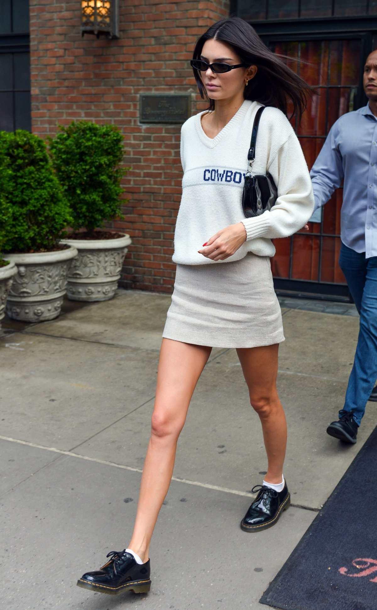 Kendall Jenner wearing a khakhi close fitting mini skirt