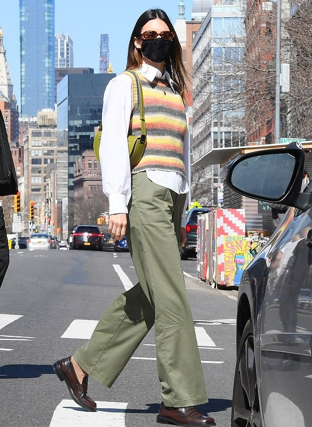Kendall Jenner rocking square round brown slip on loafers with flat heel