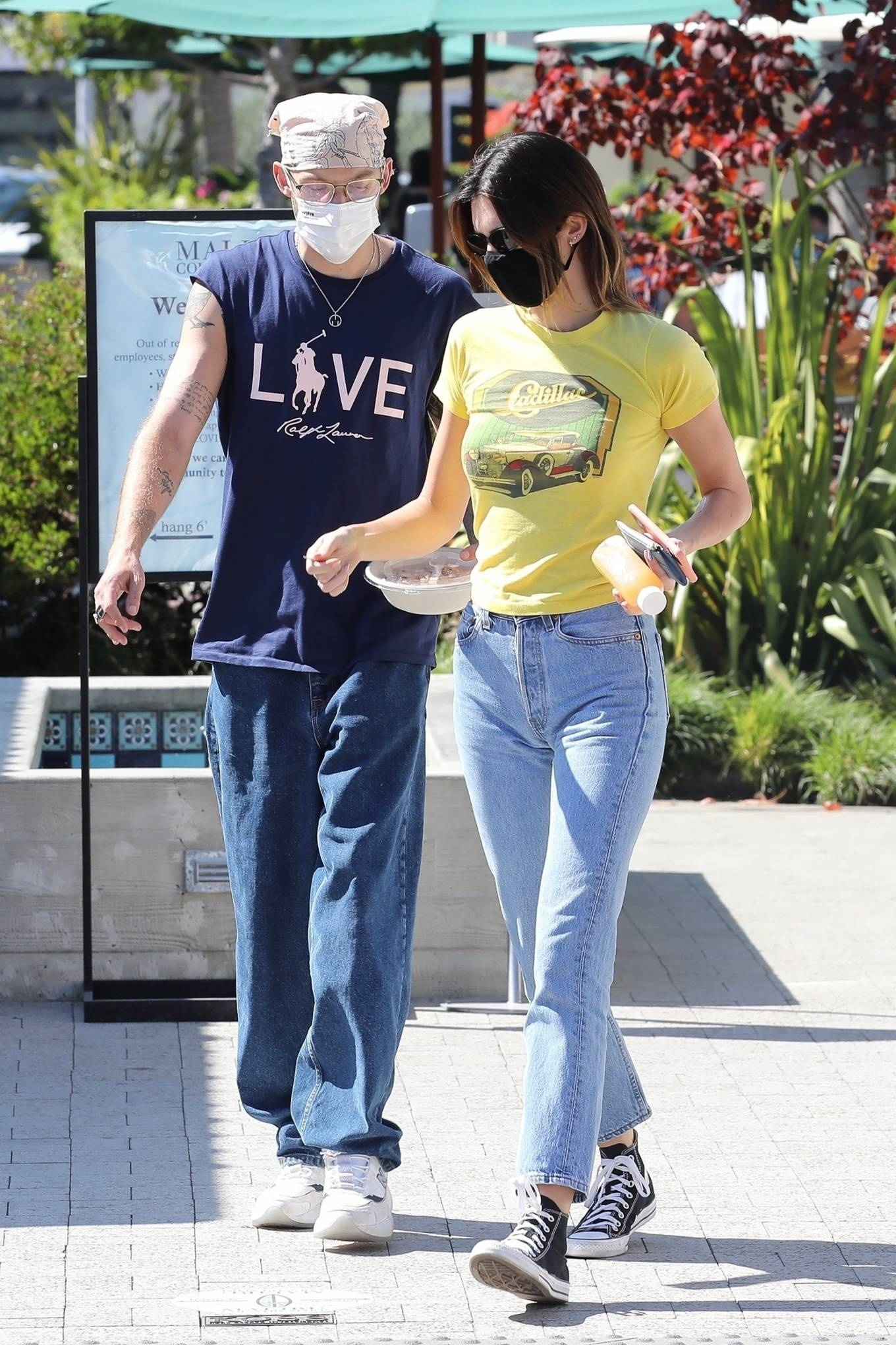 Kendall Jenner rocking a yellow graphic print tee with short sleeves and a crew neck