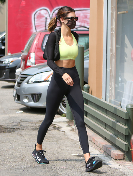 Kendall Jenner wearing a light green Adidas sports bra with a round neck
