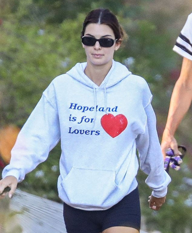 Kendall Jenner rocking a oversized light grey hoodie while hiking with dad Caitlyn Jenner and her beloved pup Pyro in Malibu