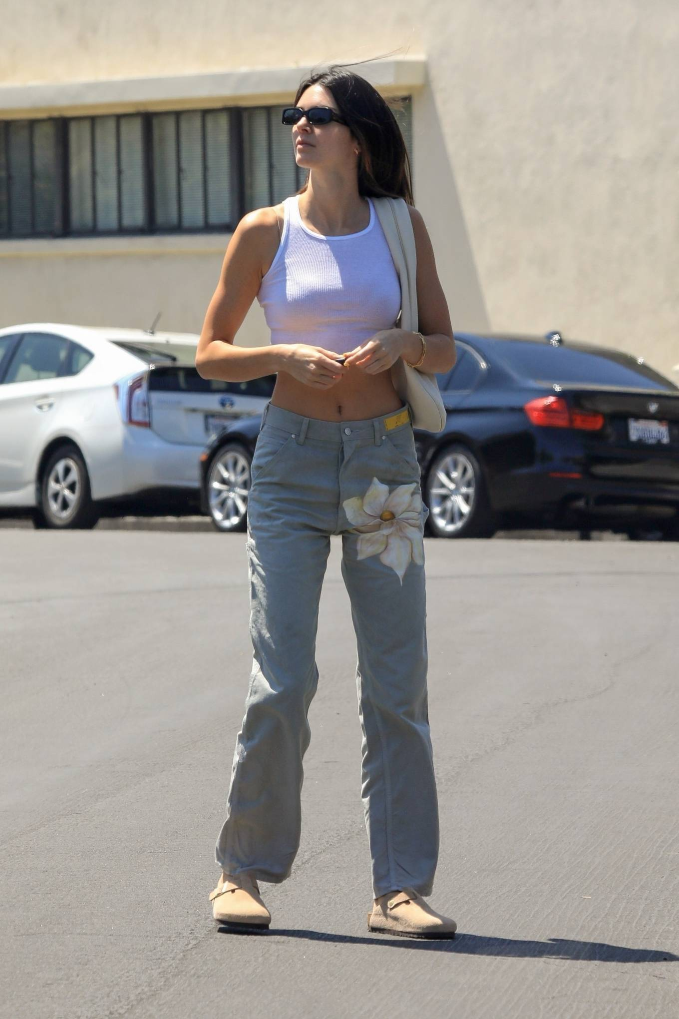 Kendall Jenner rocking a fitted light grey crop top with a round neck