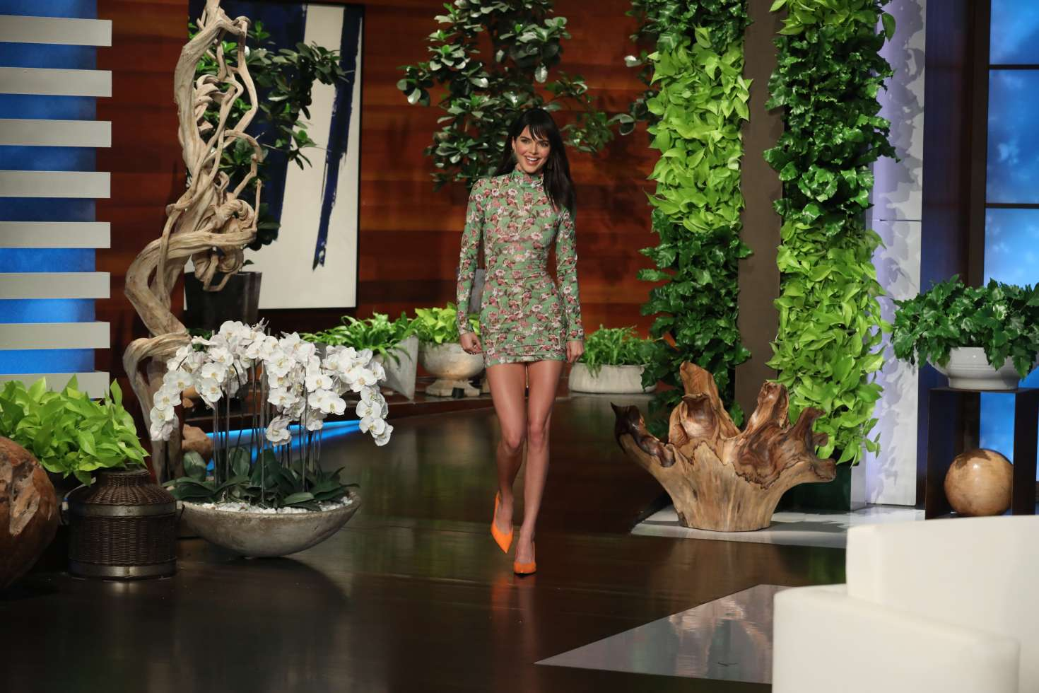 Kendall Jenner rocking a formfitting sea green dress with full sleeves, floral print and a turtleneck