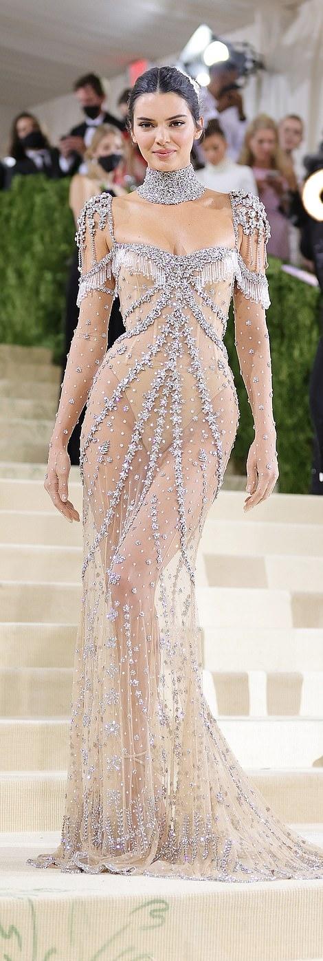 Kendall Jenner dazzled in round Nude beige crisscross tie sandals with high heel