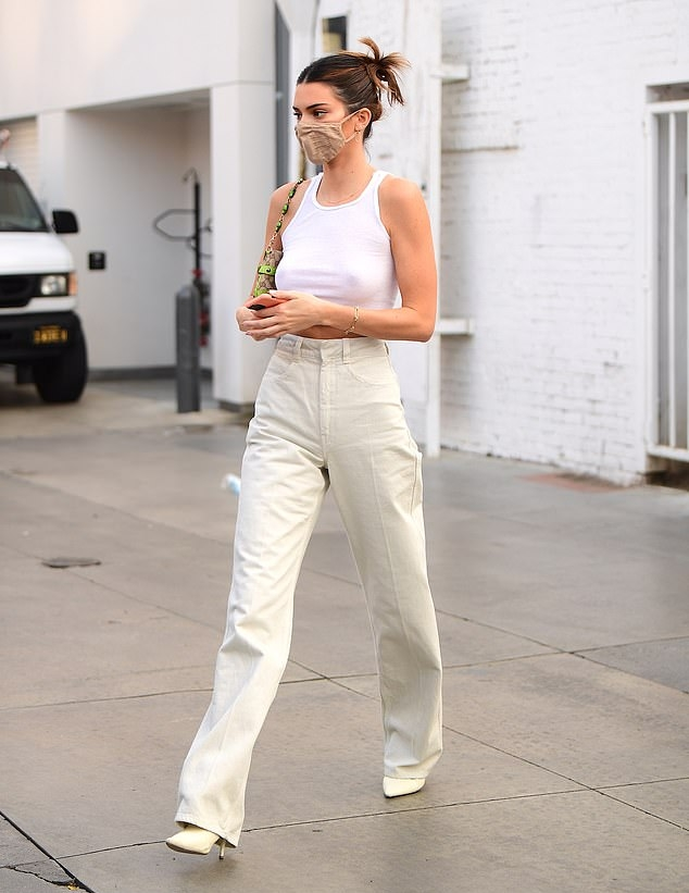 Kendall Jenner donning a white basic tank top with a round neck