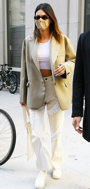 Kendall Jenner wearing a oversized Taupe open front blazer with long sleeves, peak lapel collar and flap pockets