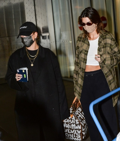 Kendall Jenner donning white leather lace-up sneakers