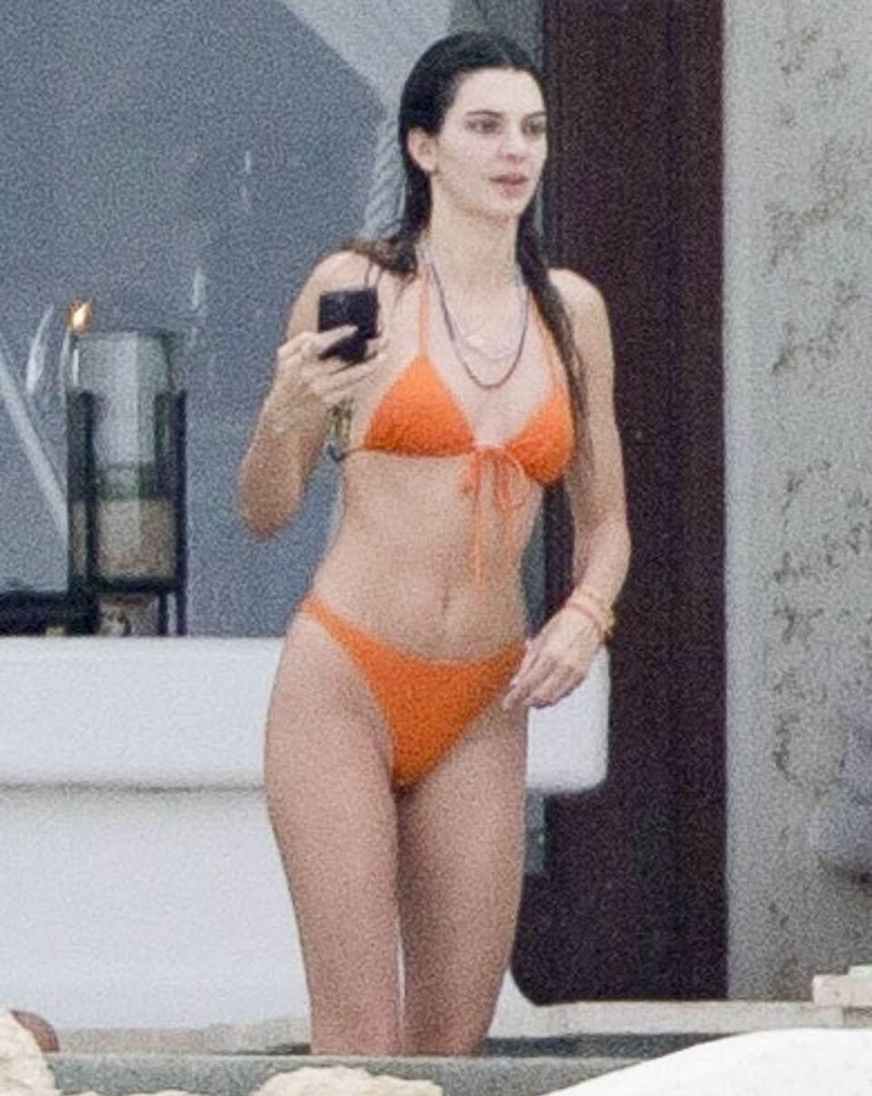 Kendall Jenner donning skimpy orange low rise bikini bottom
