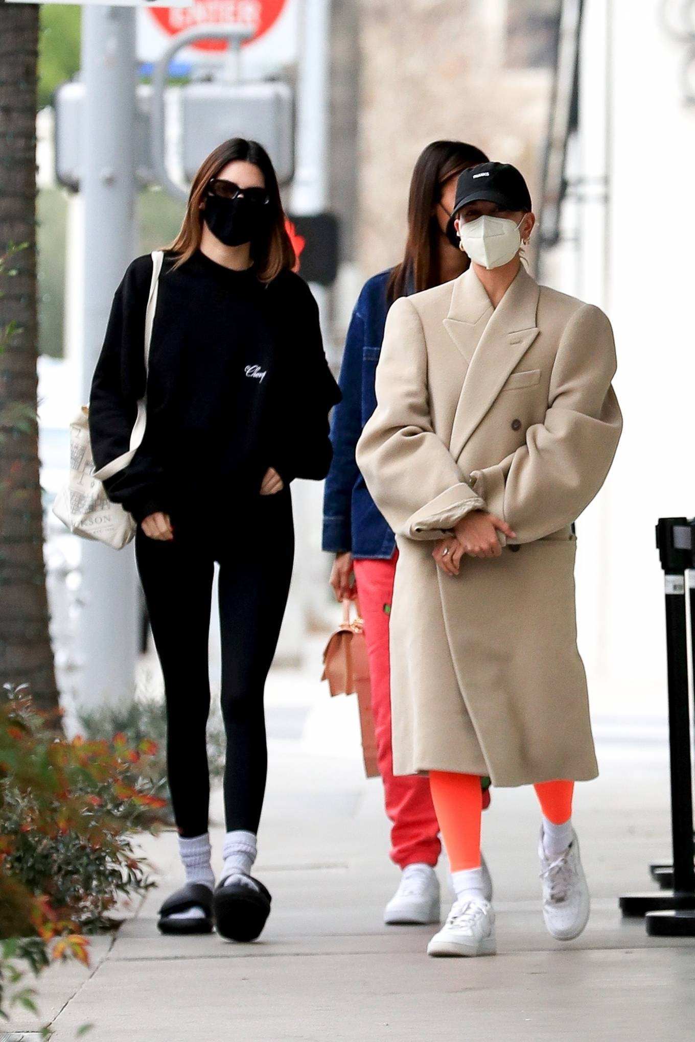 Kendall Jenner donning a Oversized black Cherry sweatshirt with full sleeves and ribbed hem